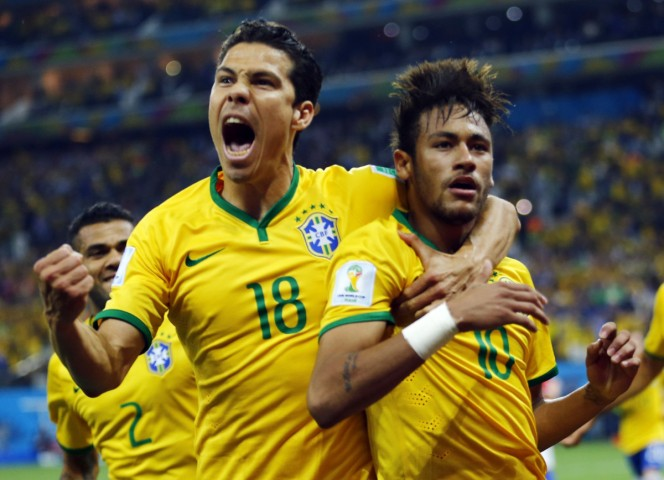 Brazil's Neymar and Hernanes celebrate after Neymar scored a goal from a penalty kick during the 2014 World Cup opening match against Croatia at the Corinthians arena in Sao Paulo