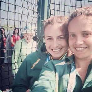 The Queen is a photobomber.