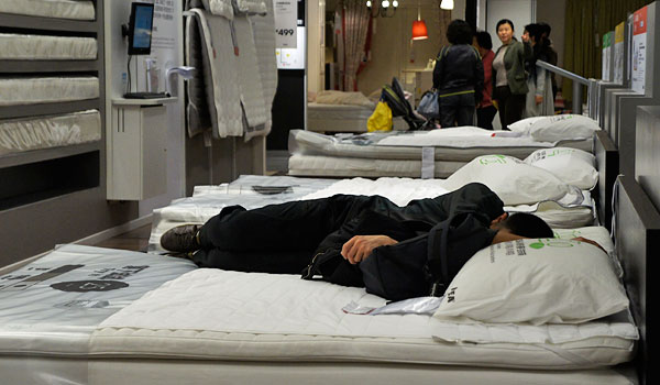 A shopper naps at Ikea.